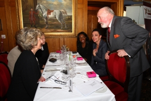 Senator David Norris in deep discussion with Soroptimist members